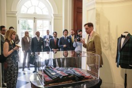 Event Party : WASHINGTON, DC - MAY 14: Nick Foulkes, (R) curator of the exhibition, gives a tour to attendees at Savile Row Bespoke and America at the British Ambassador's Residence on May 14, 2015 in Washington, DC. (Photo by Greg Kahn/Getty Images for The British Embassy)