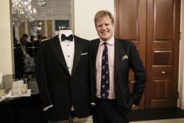Event Party : WASHINGTON, DC - MAY 14: Elijah Duckworth-Schachter in front of his grandfather, Benny Goodman's dinner suit at the Savile Row and America exhibition in Washington DC.  Goodman ordered seven dinner suits during his patronage of Huntsman, wearing them regularly on stage and screen.(Photo by Greg Kahn/Getty Images for The British Embassy)